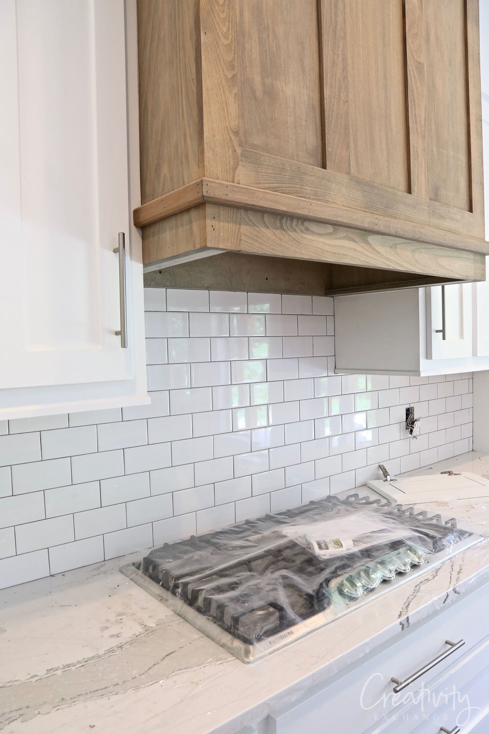 White subway tile with medium gray grout
