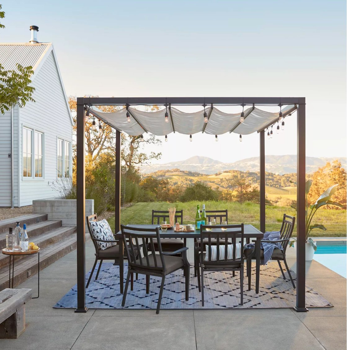 Modern roman shade pergola with retractable roof