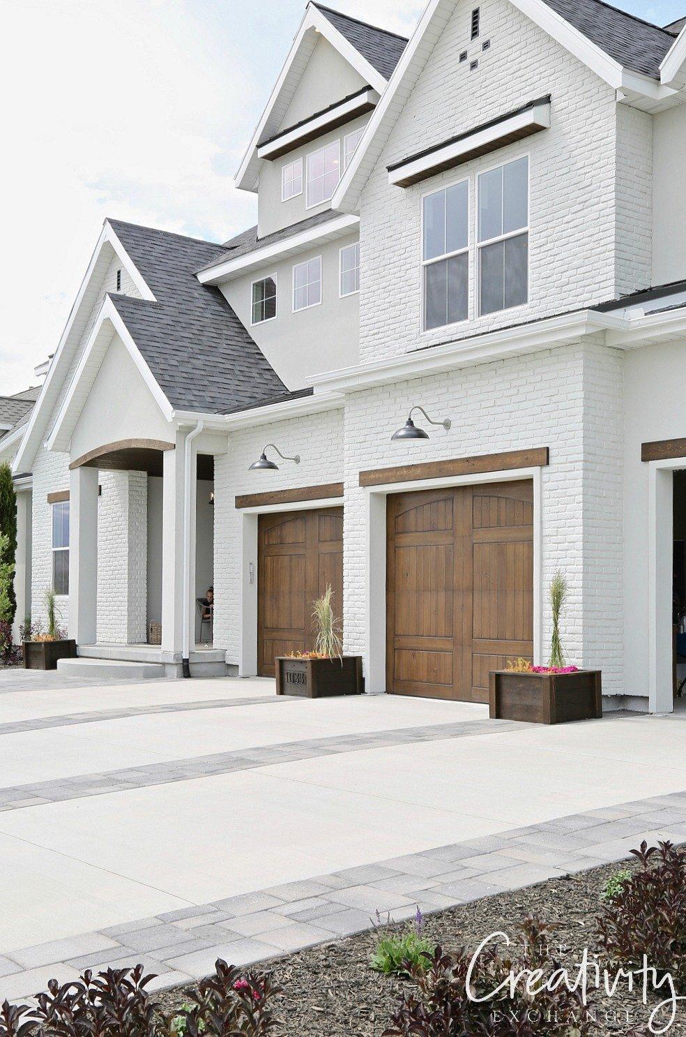 Painted brick exterior with wood garage doors