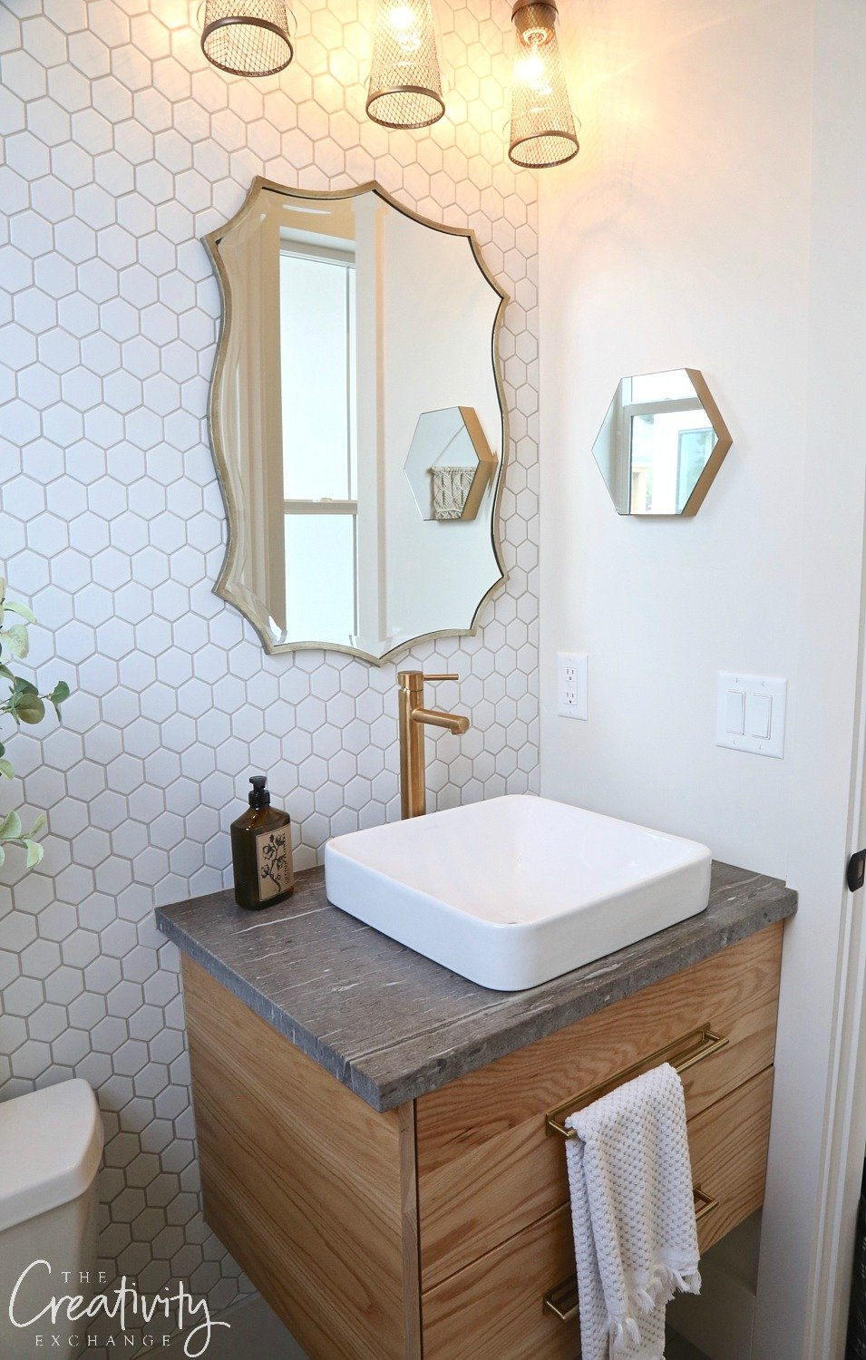 Small powder room with hexagon tile