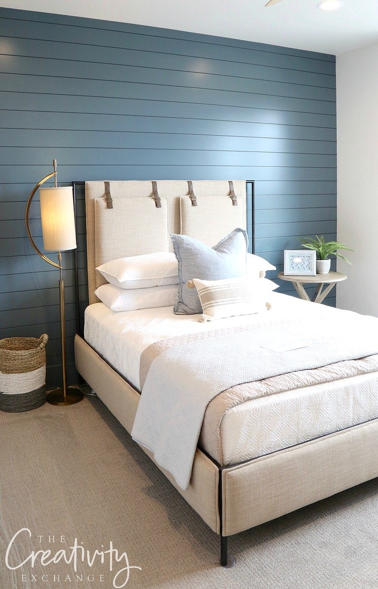 Painted shiplap accent wall color is Sherwin Williams Slate Tile