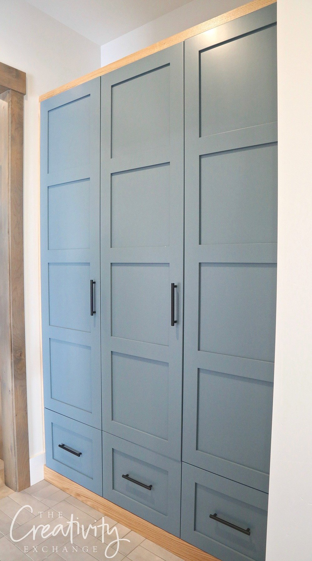 Mudroom cabinetry painted with Sherwin Williams Slate Tile