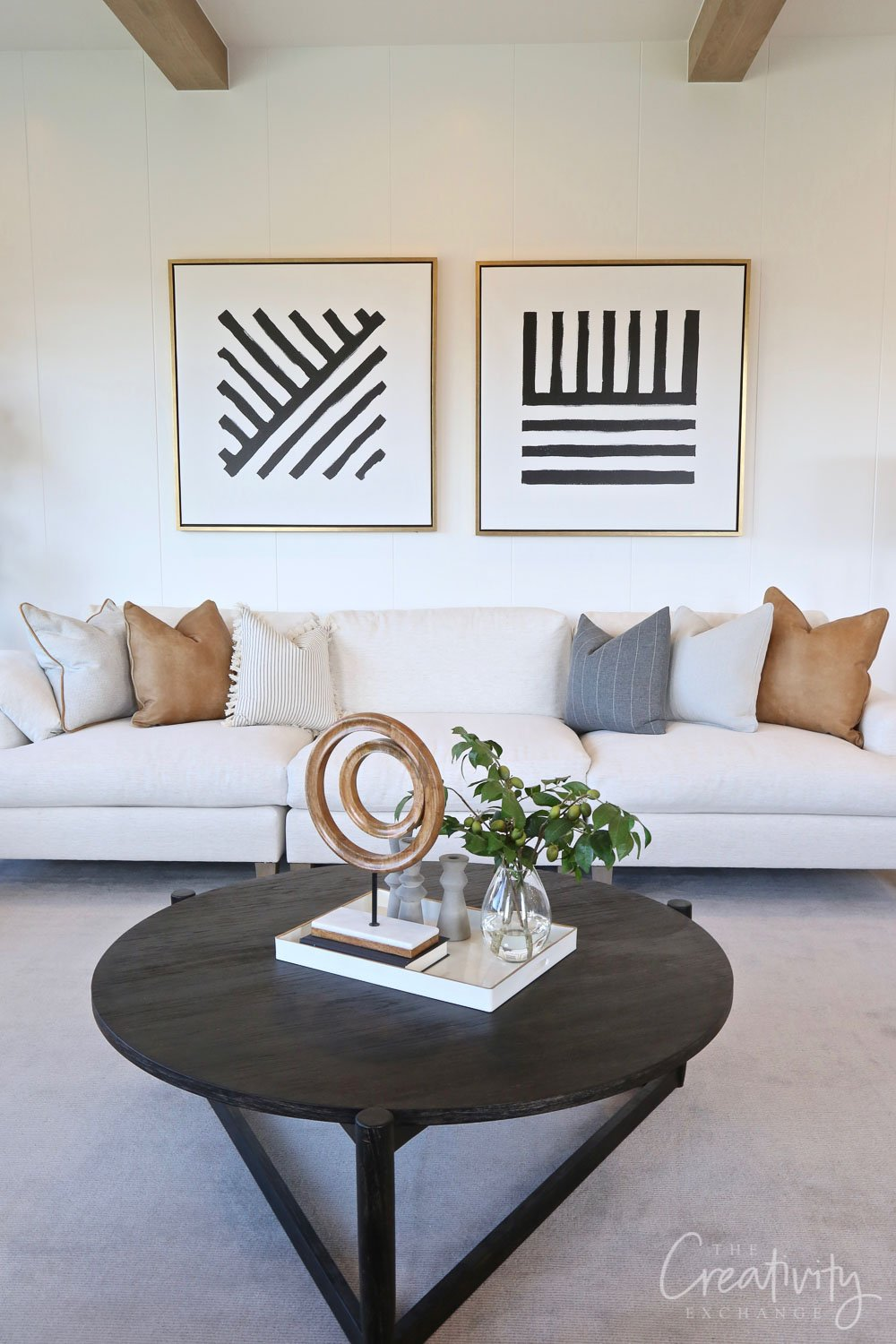 Sofa with pillows and accent art