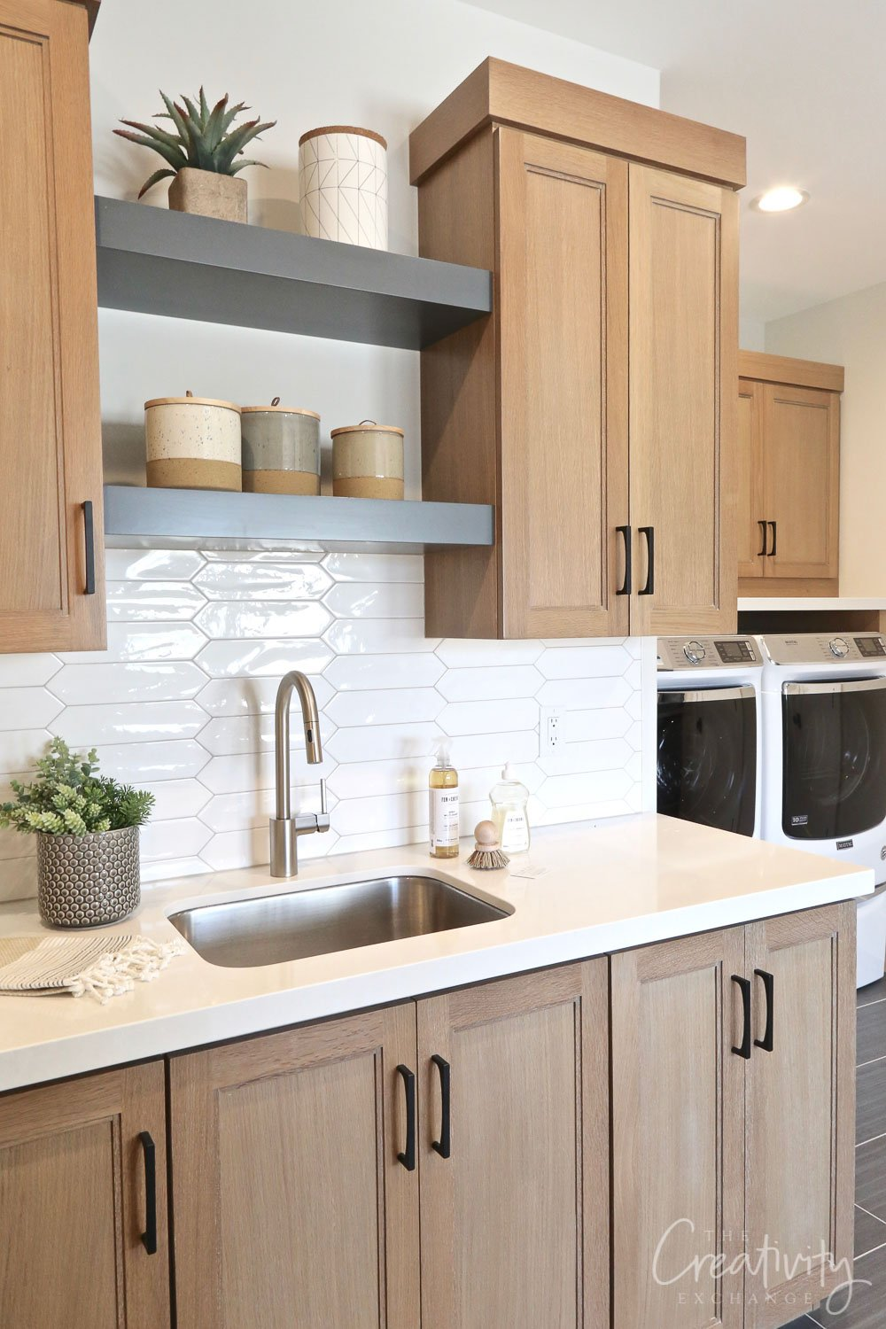 Large laundry room with oak cabinetry