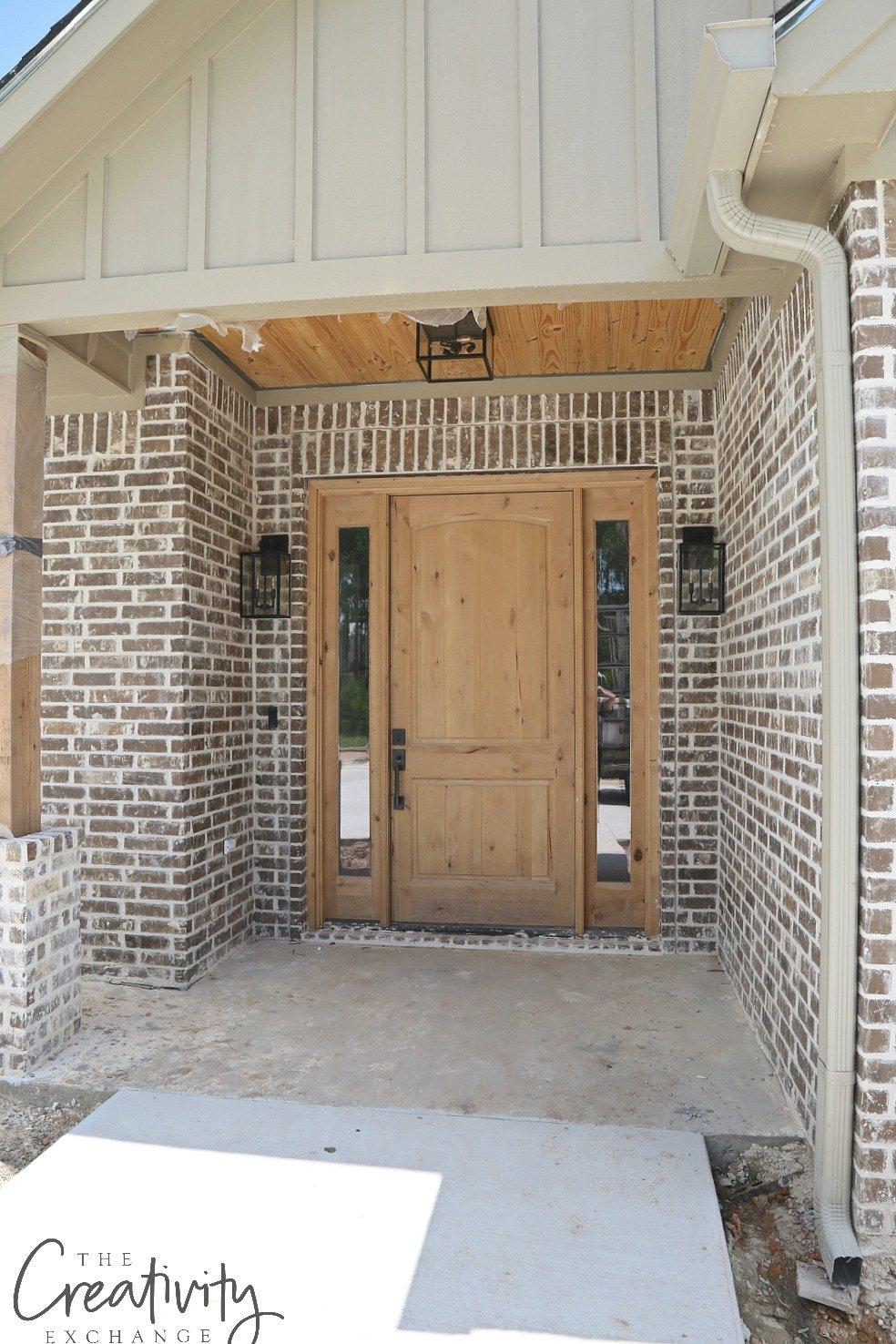 Brick home with solid wood door