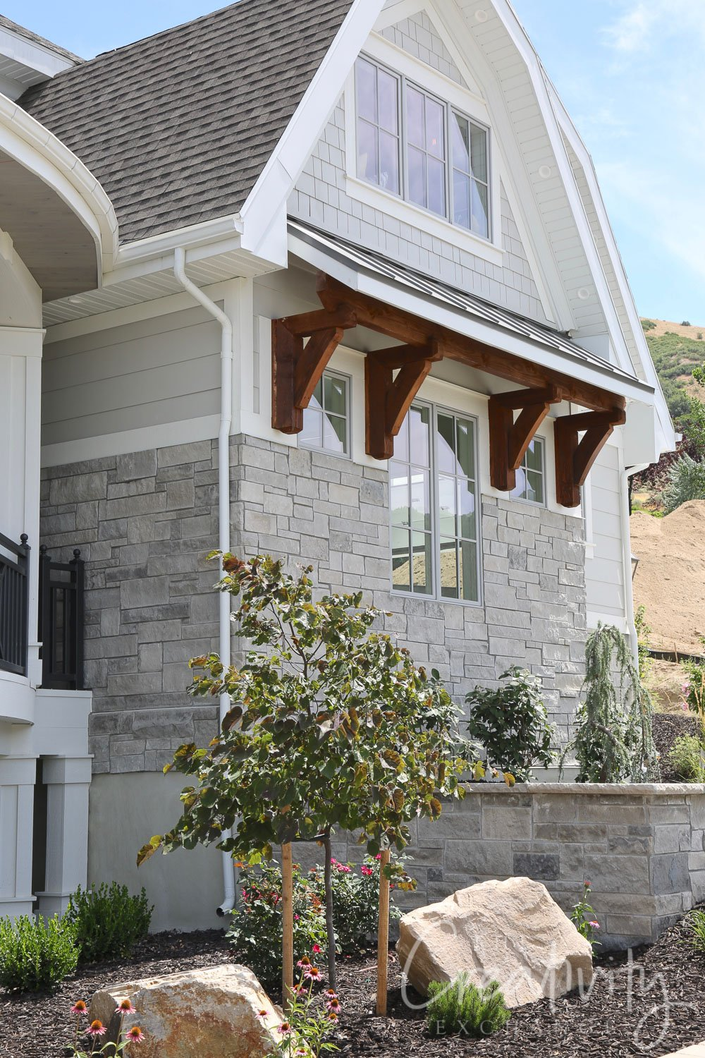 Wood and metal exterior window awnings