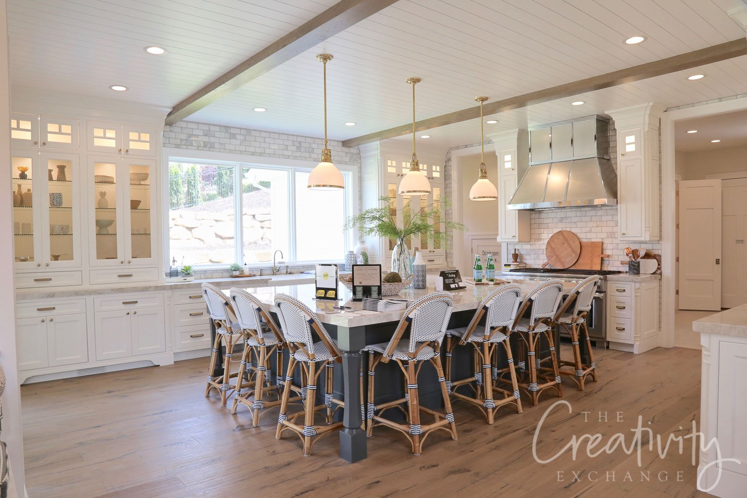 Large kitchen with huge center island and oak floors.