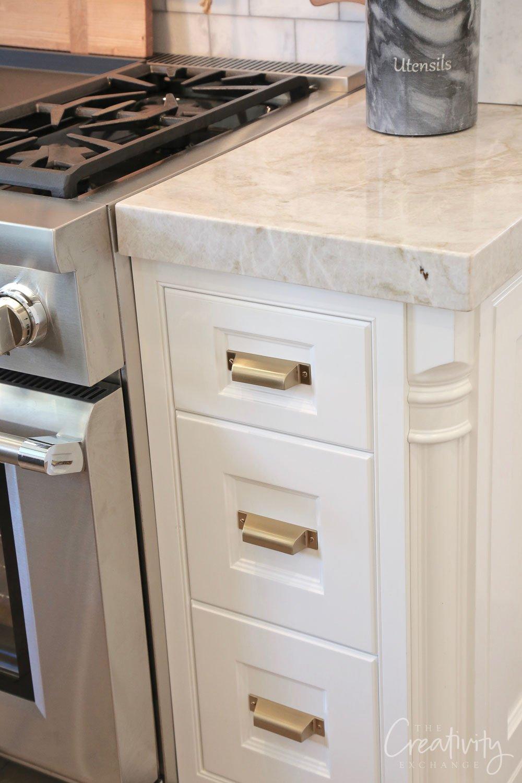 Brass kitchen cabinet pulls.