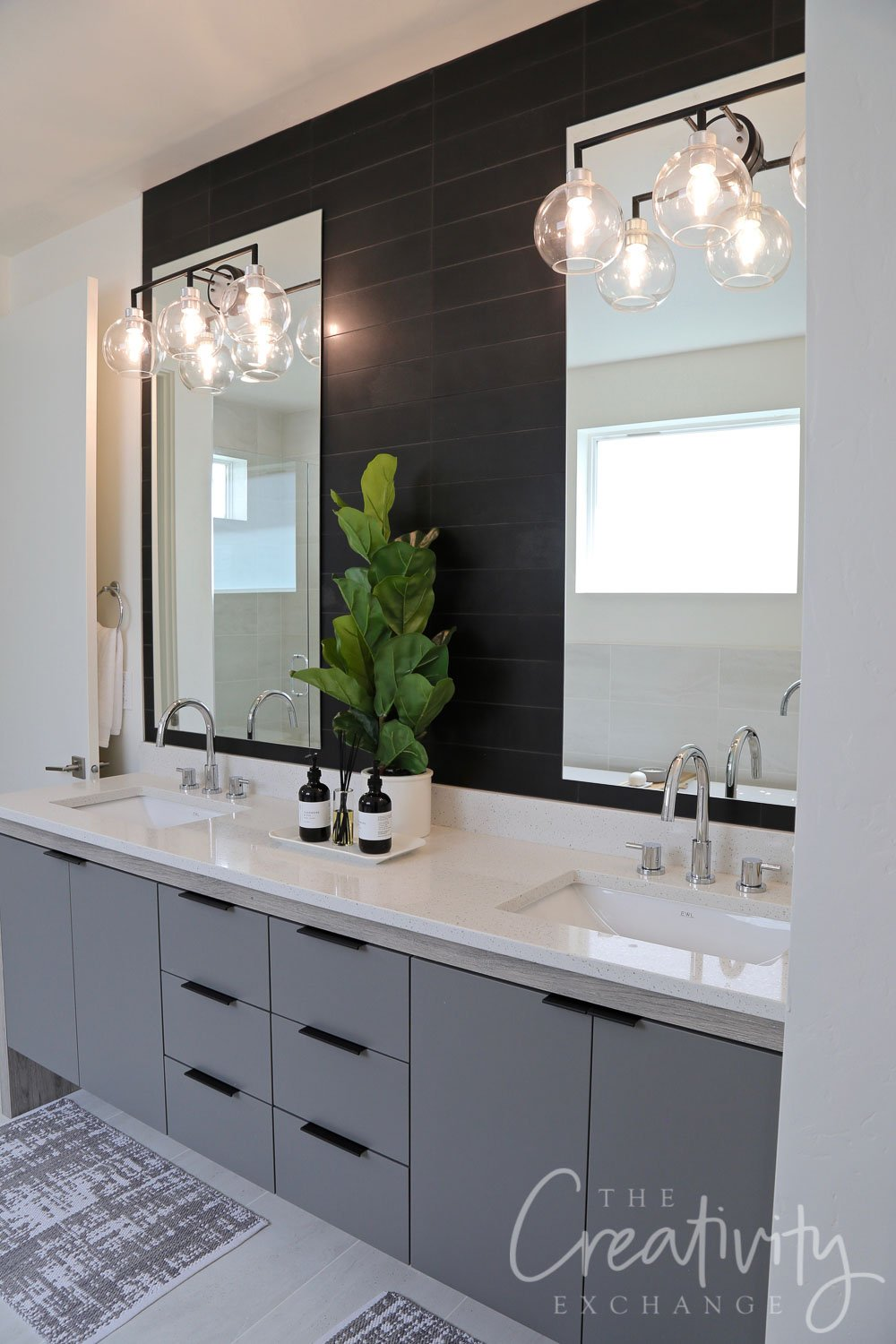 Black tiled bathroom accent wall