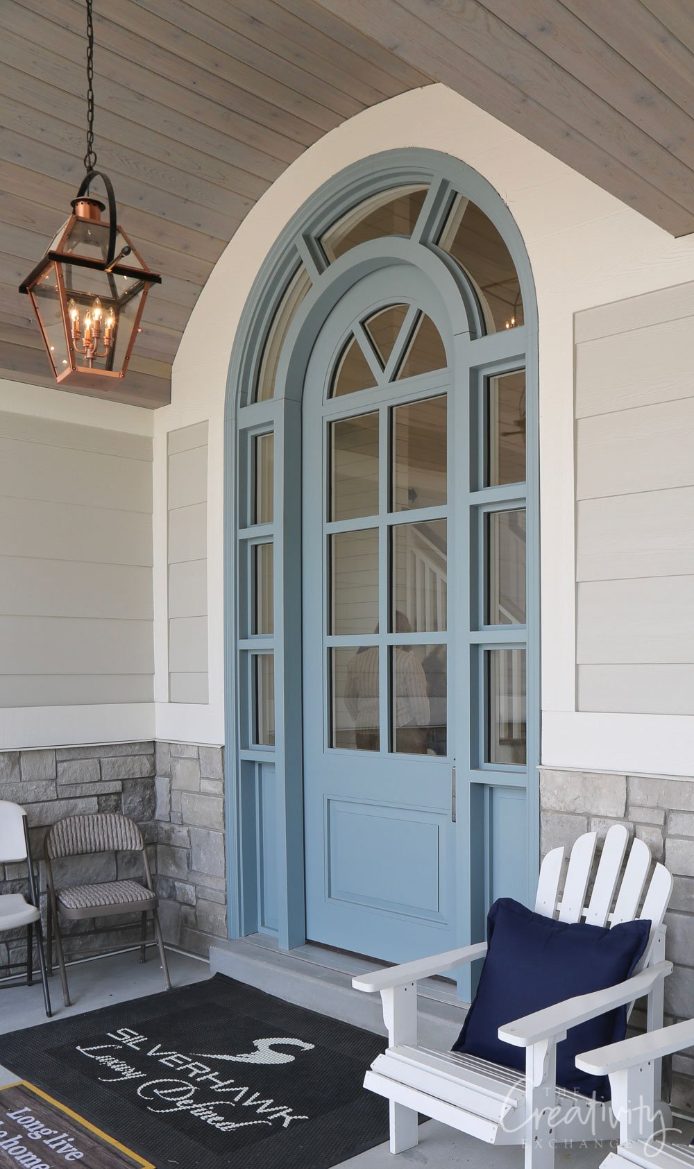 Blue arched front door.