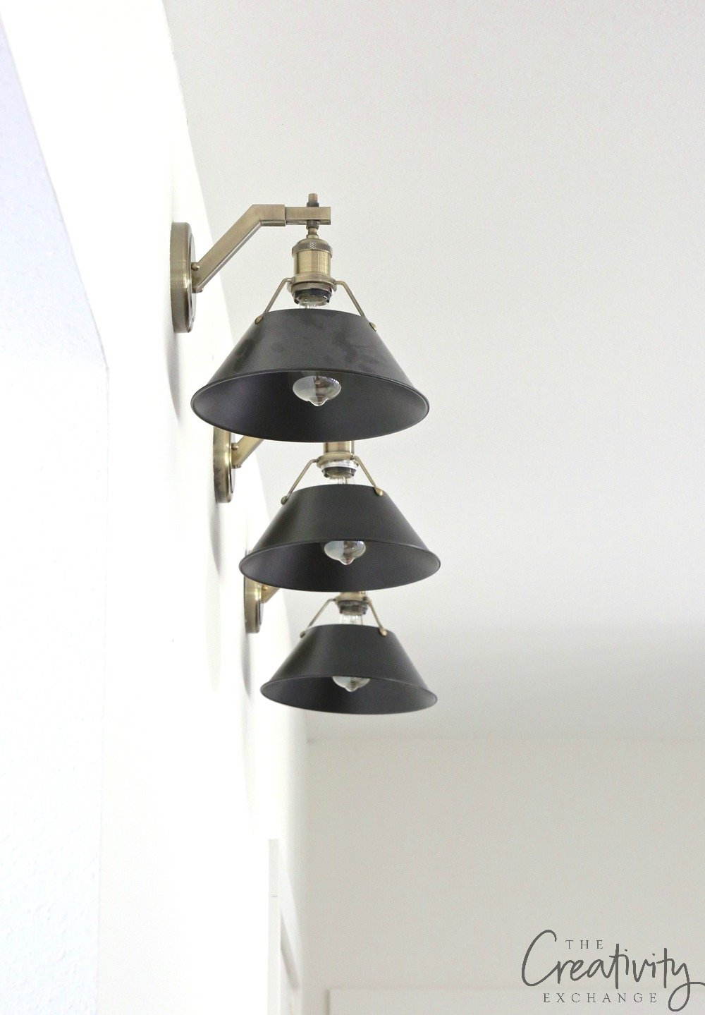 Black and brass gallery wall sconces