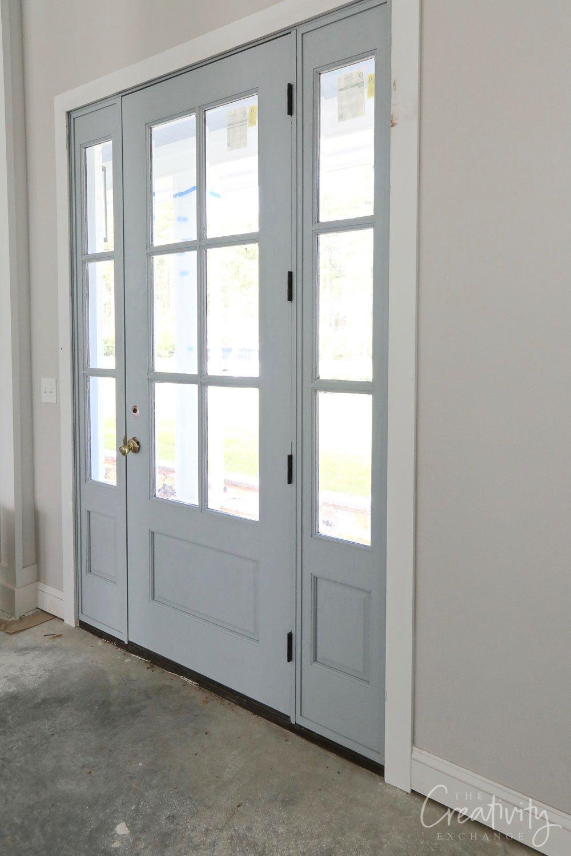 Front door is a light warm blue gray.