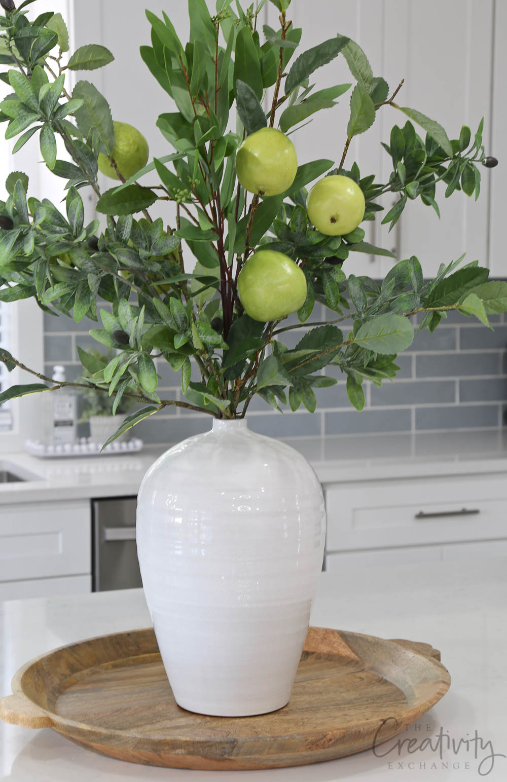 White vase full of faux quince