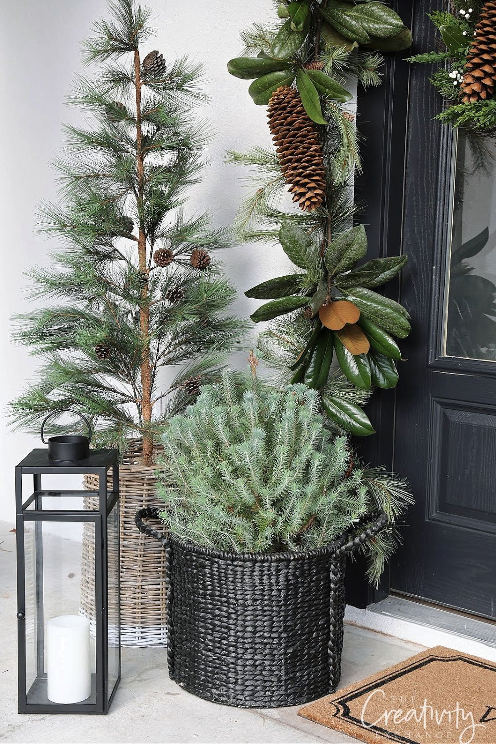 Basket of Christmas trees on front porch