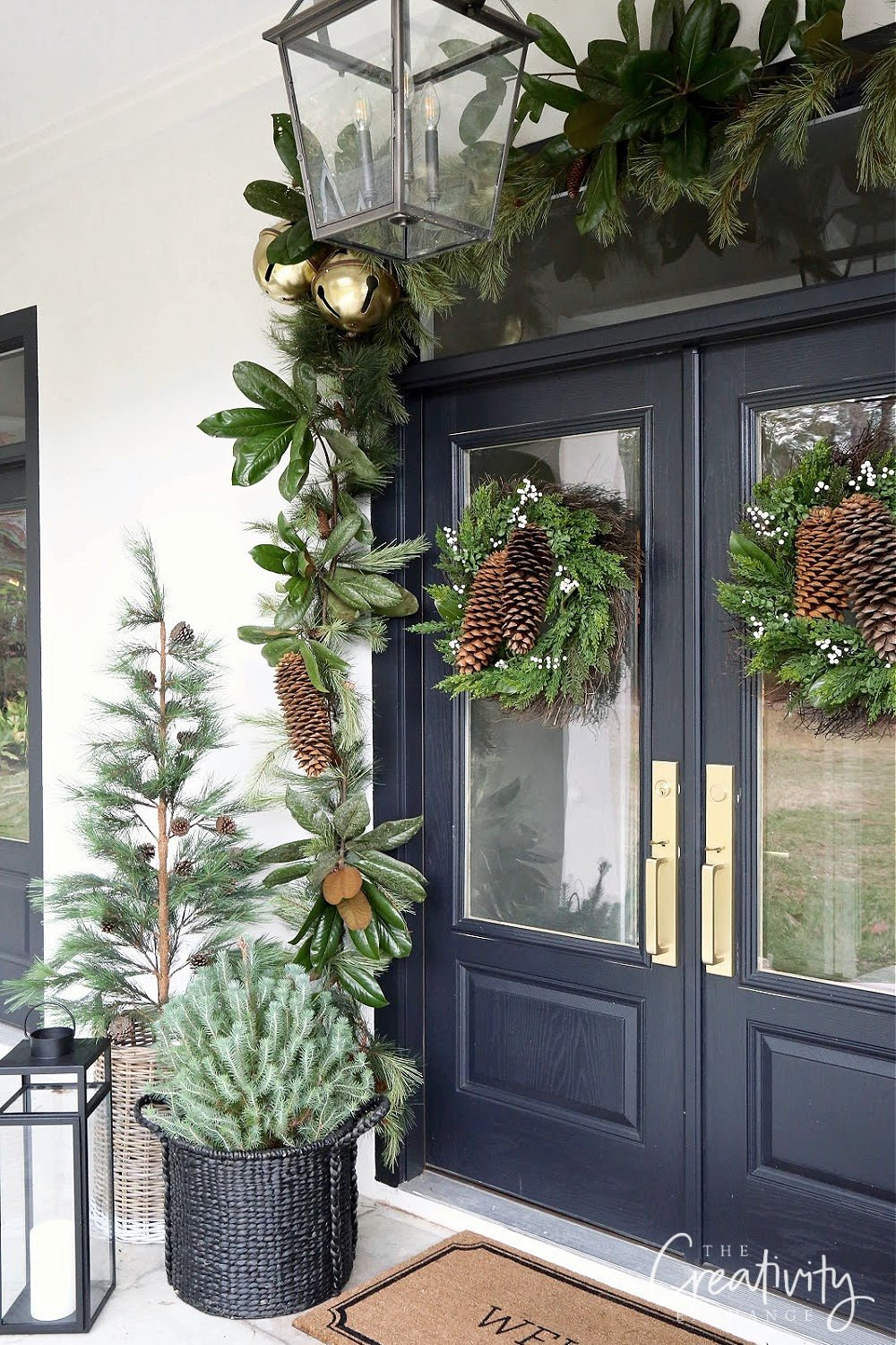 Christmas decorated front porch with double french doors