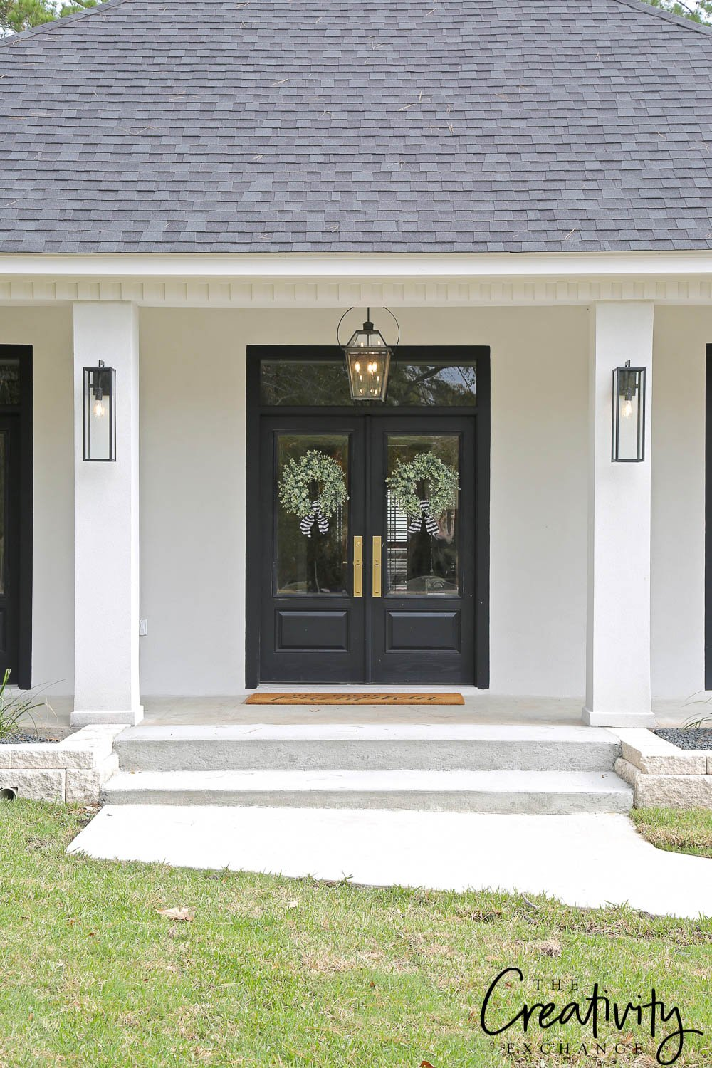 White exterior stucco with double French doors