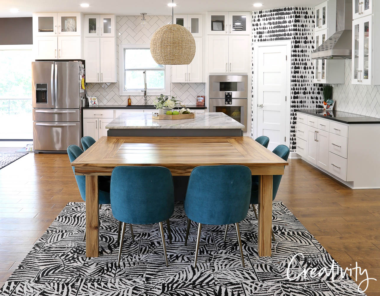 Contrasting kitchen with bold black and white pattern.