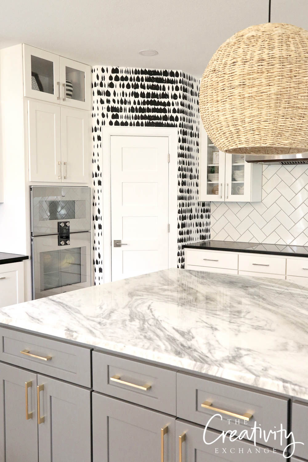 Kitchen with black and white wall covering