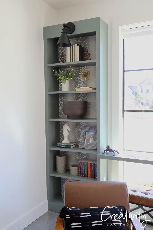 Custom bookshelf with antelope wallpaper