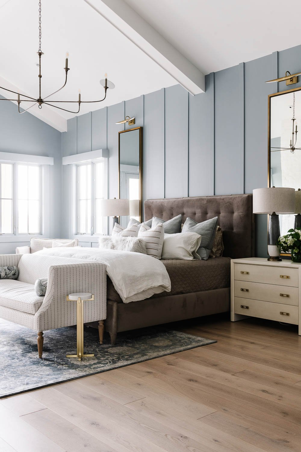 Primary bedroom with soft blue painted walls