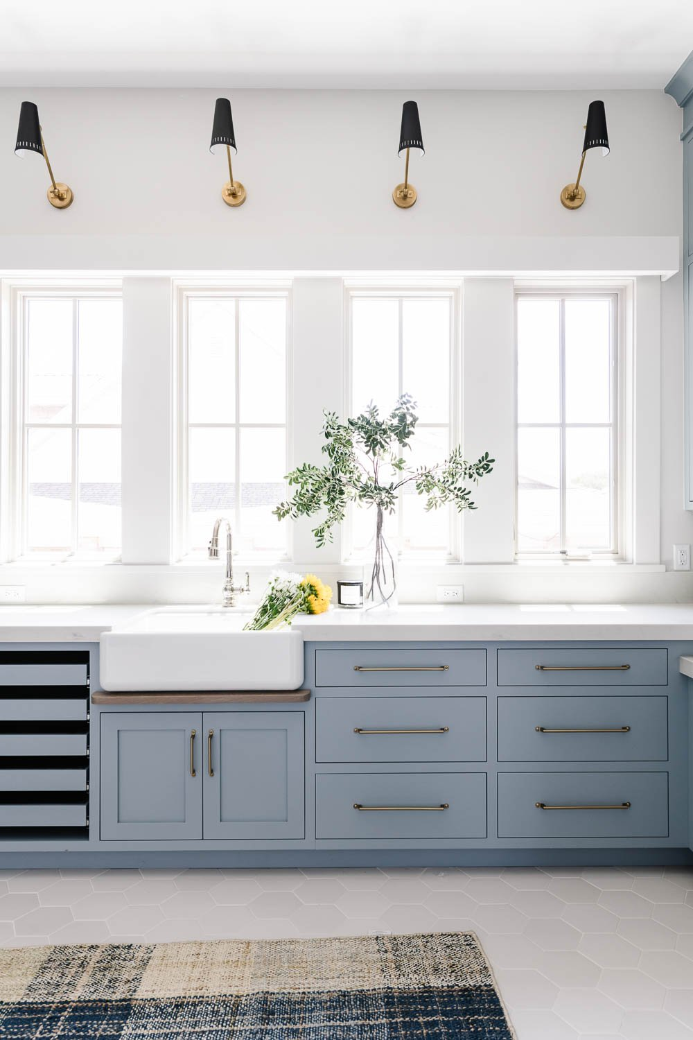 Soft blue laundry room cabinetry and storage