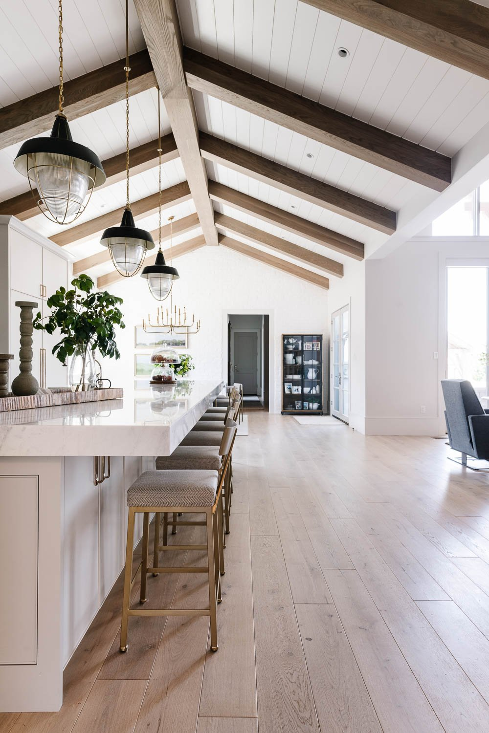 Kitchen with cathedral ceilings and beams