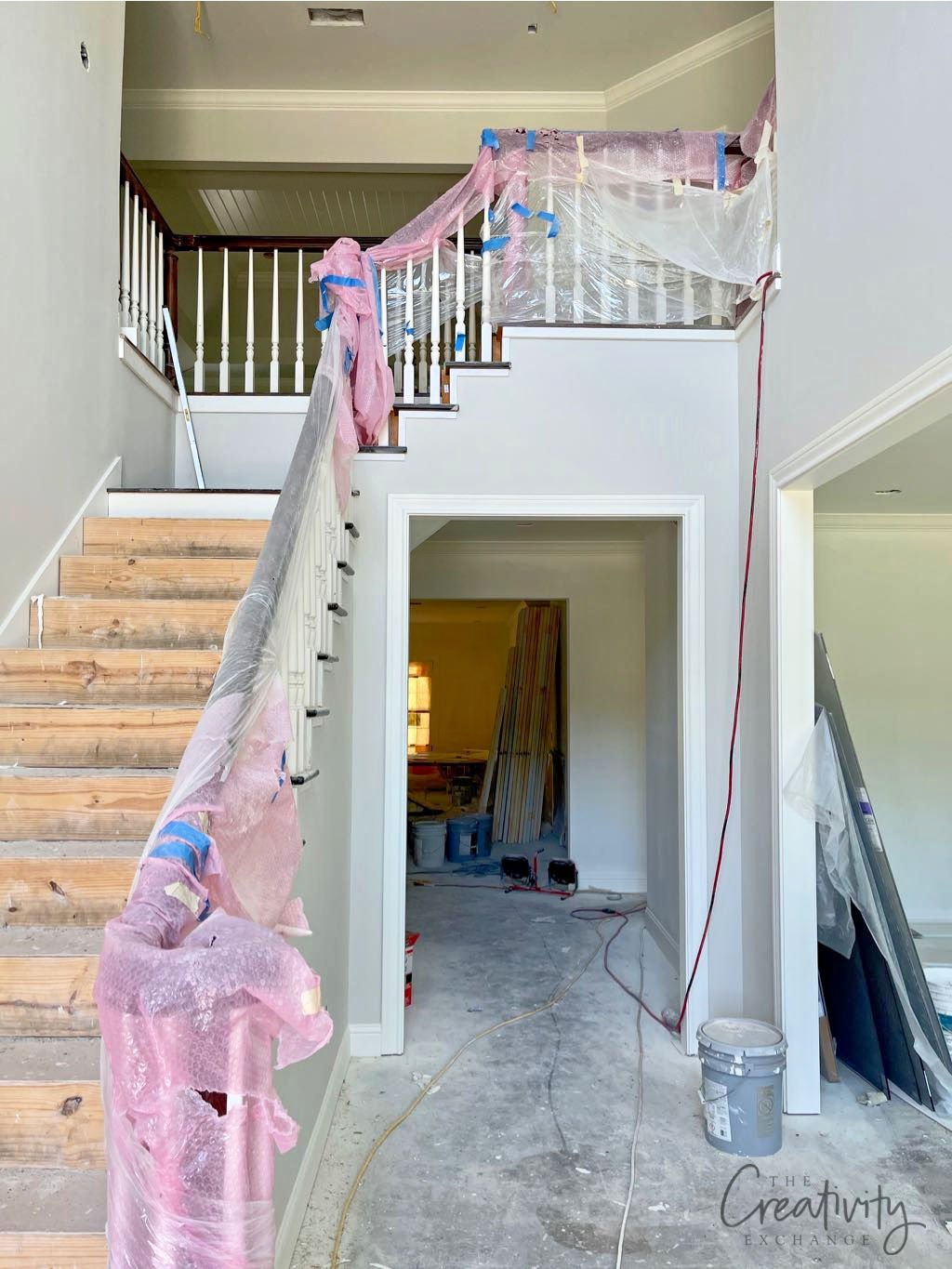 Entryway painted with Sherwin Williams Drift of Mist