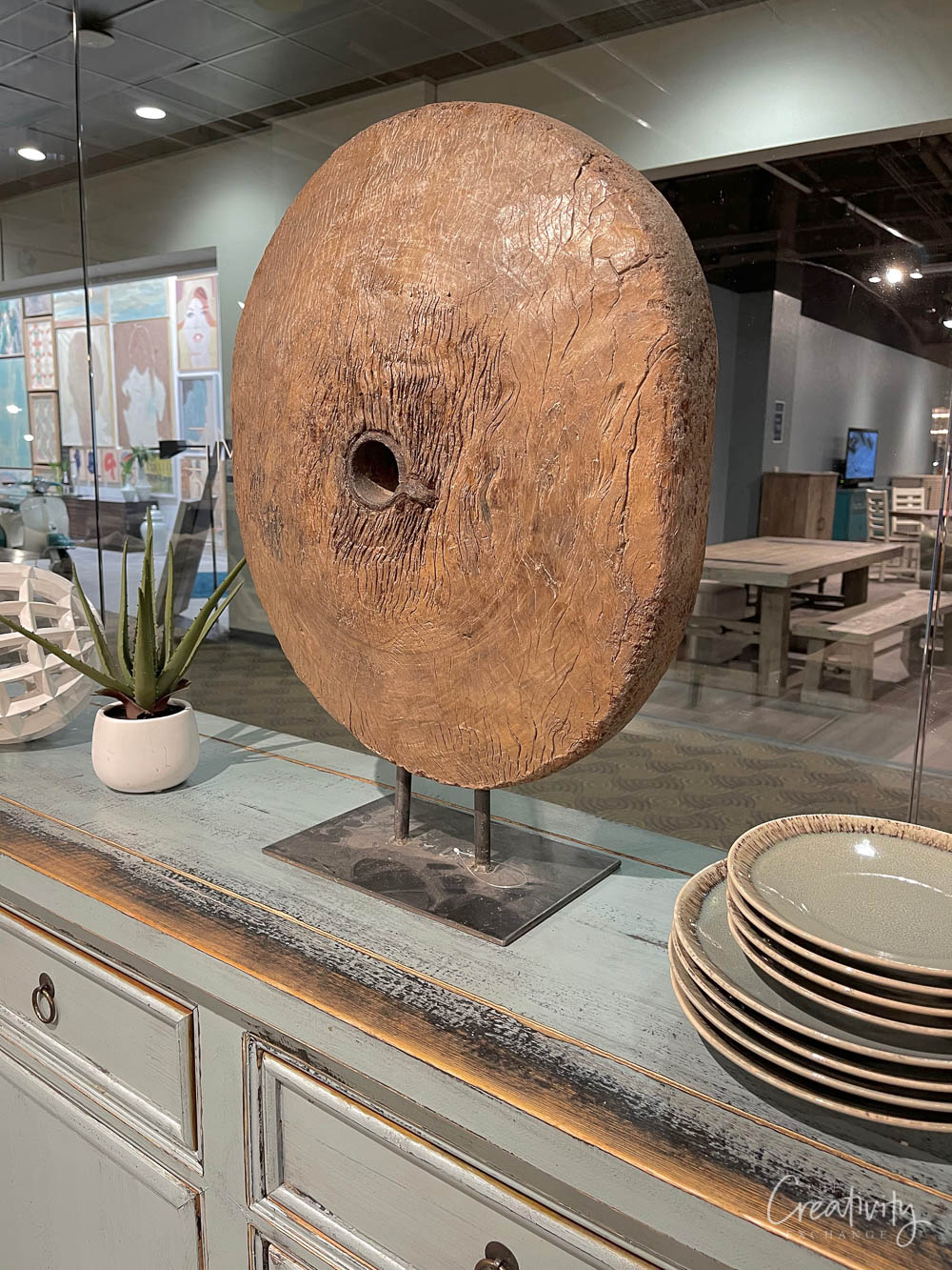 Large round wood piece on stand