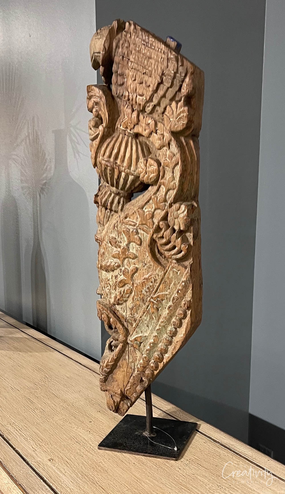 Carved wood piece on a stand