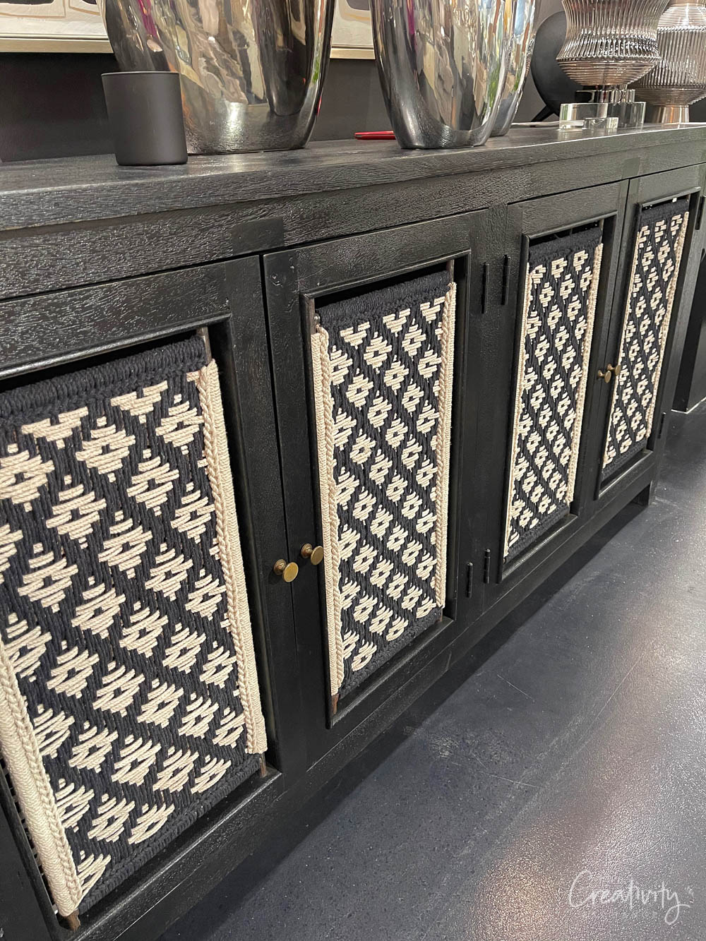 Black woven patterned cabinet console table