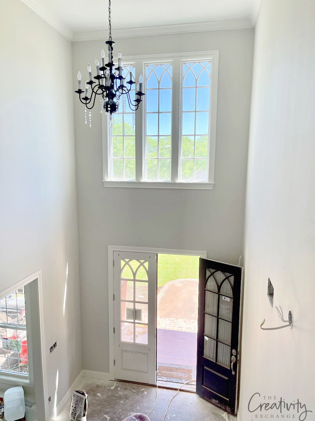 Large foyer painted with Sherwin Williams Drift of Mist