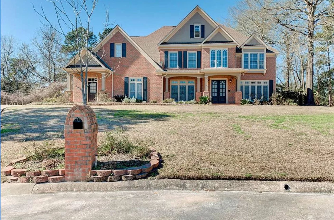 Two story traditional brick home