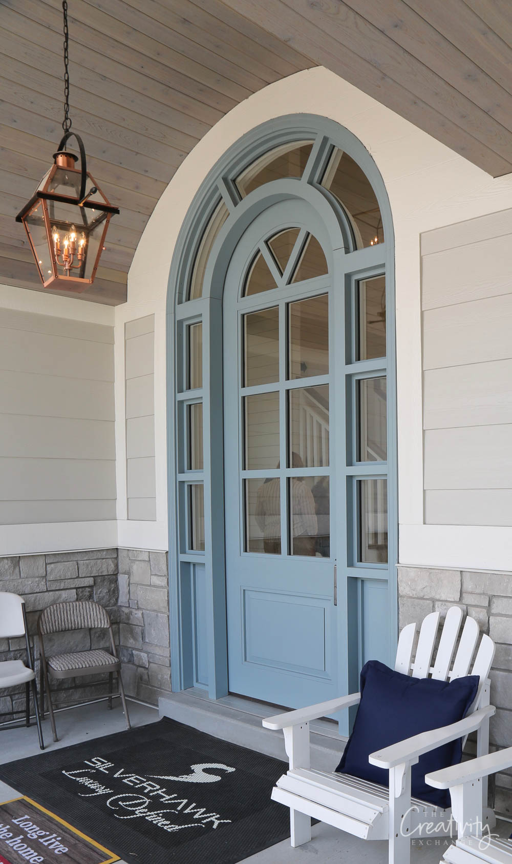 Large blue painted arched front door