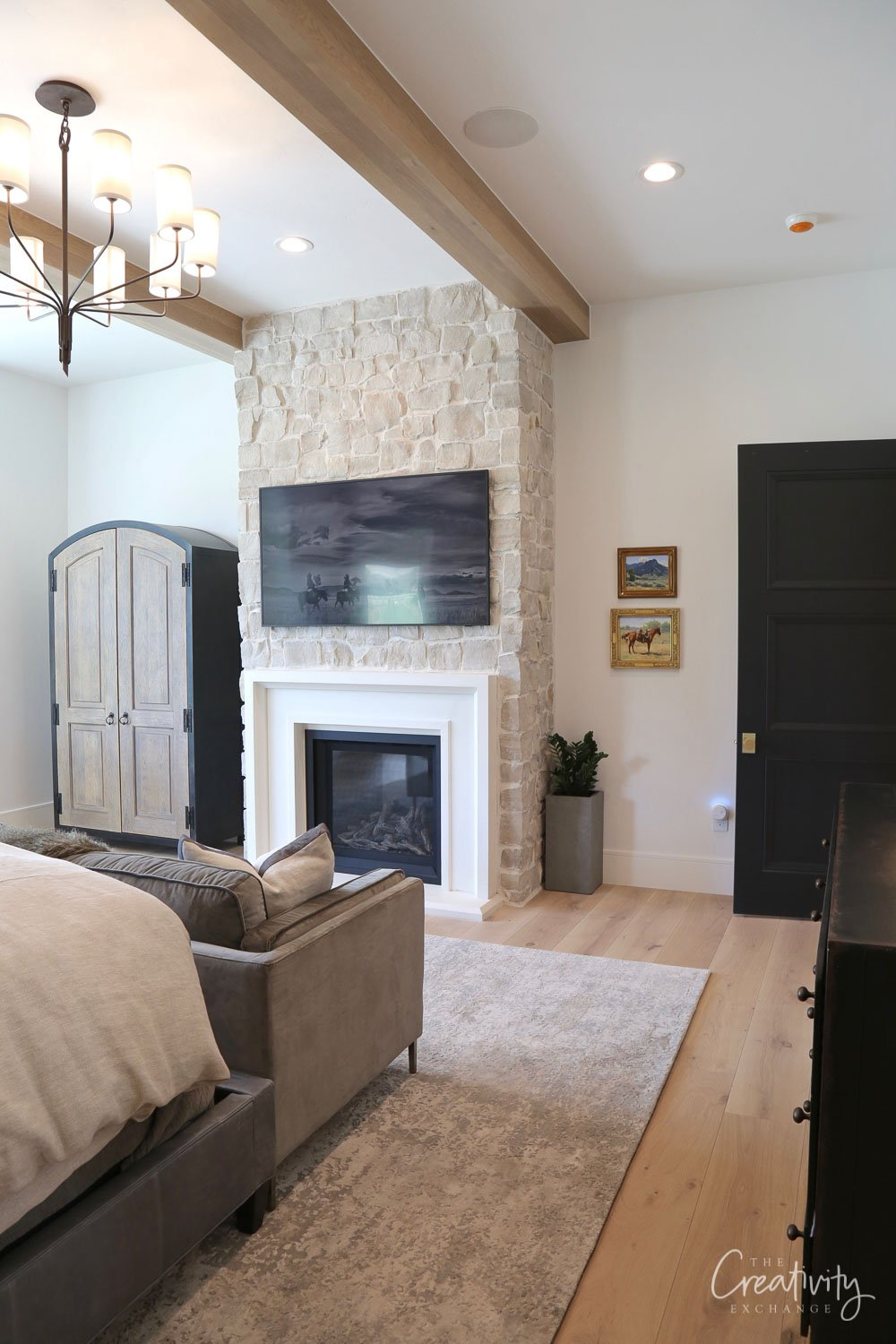 Primary Bedroom with stone fireplace