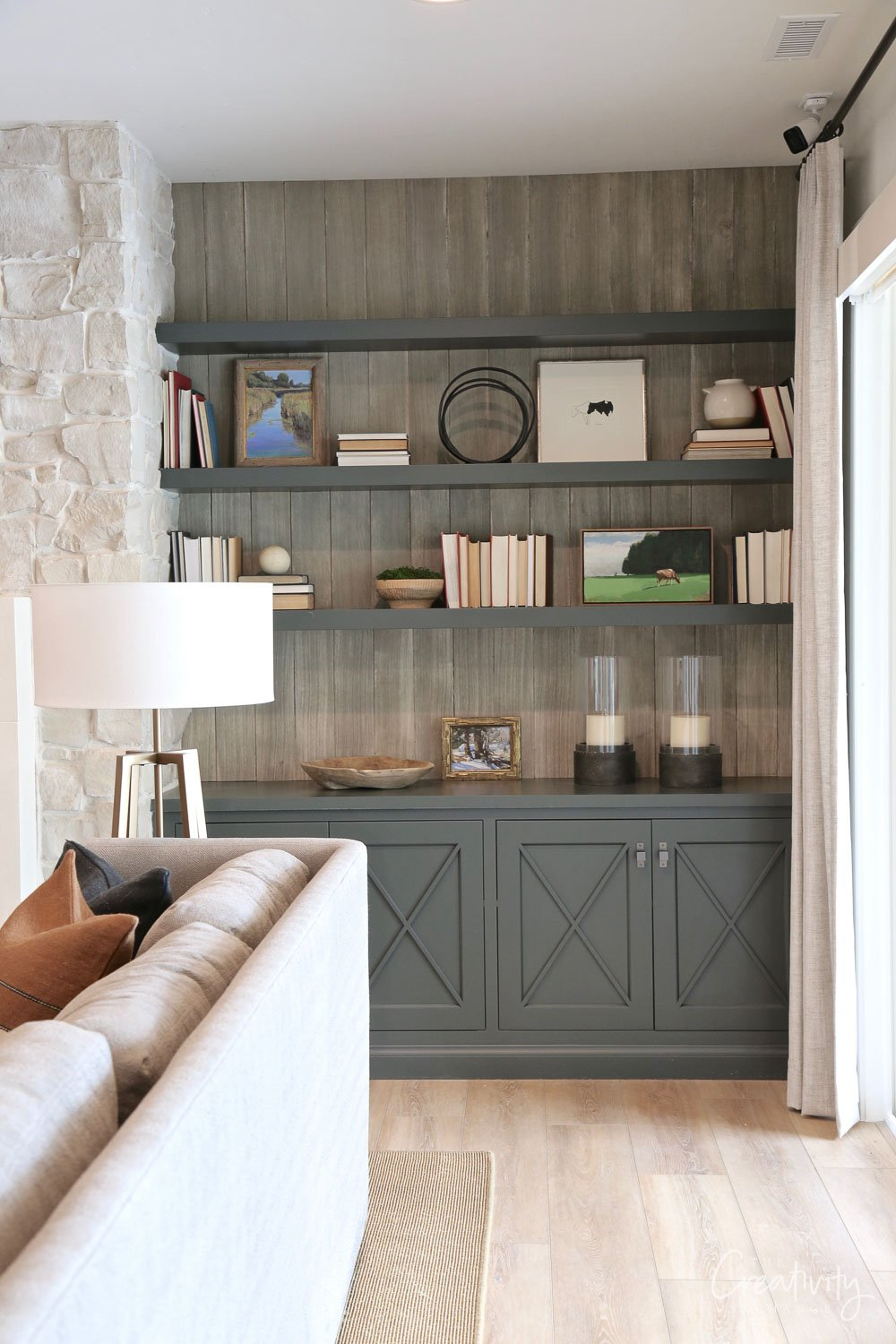 Built-in cabinets paint with Farrow and Ball Studio Green