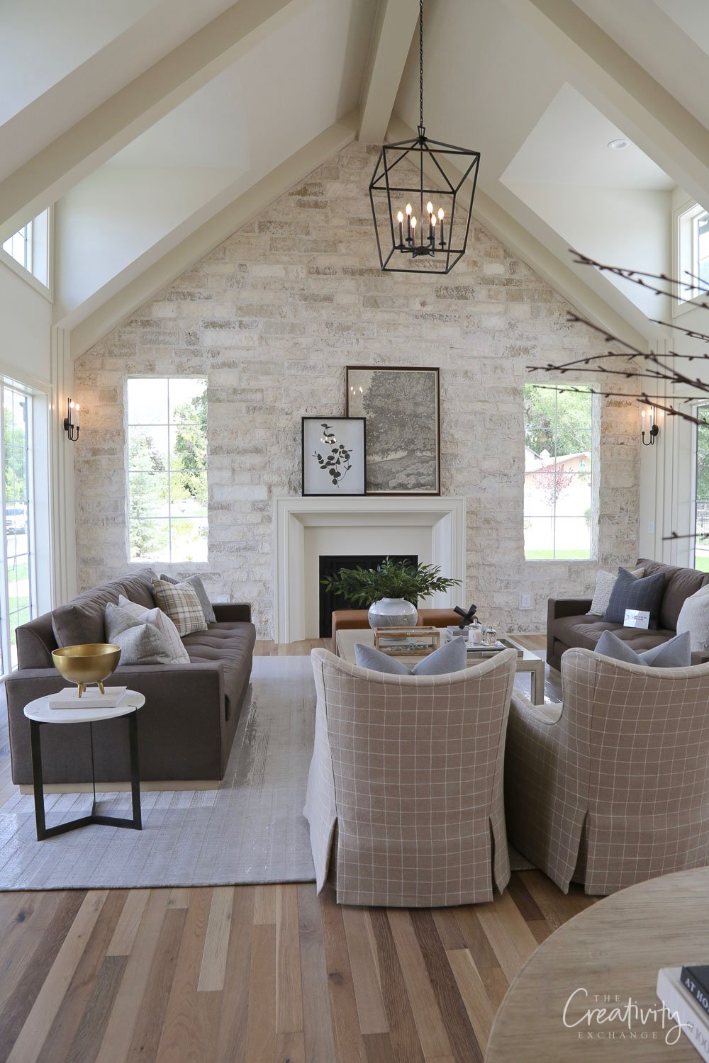 Cathedral living room with stone fireplace