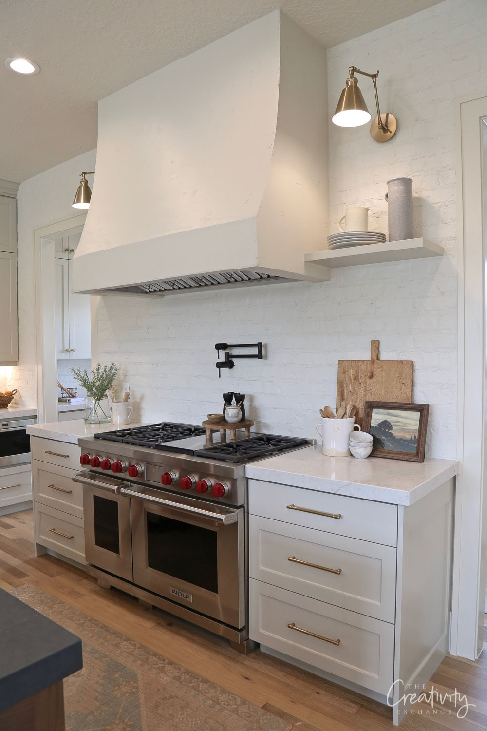 Kitchen with smooth stucco vent hood