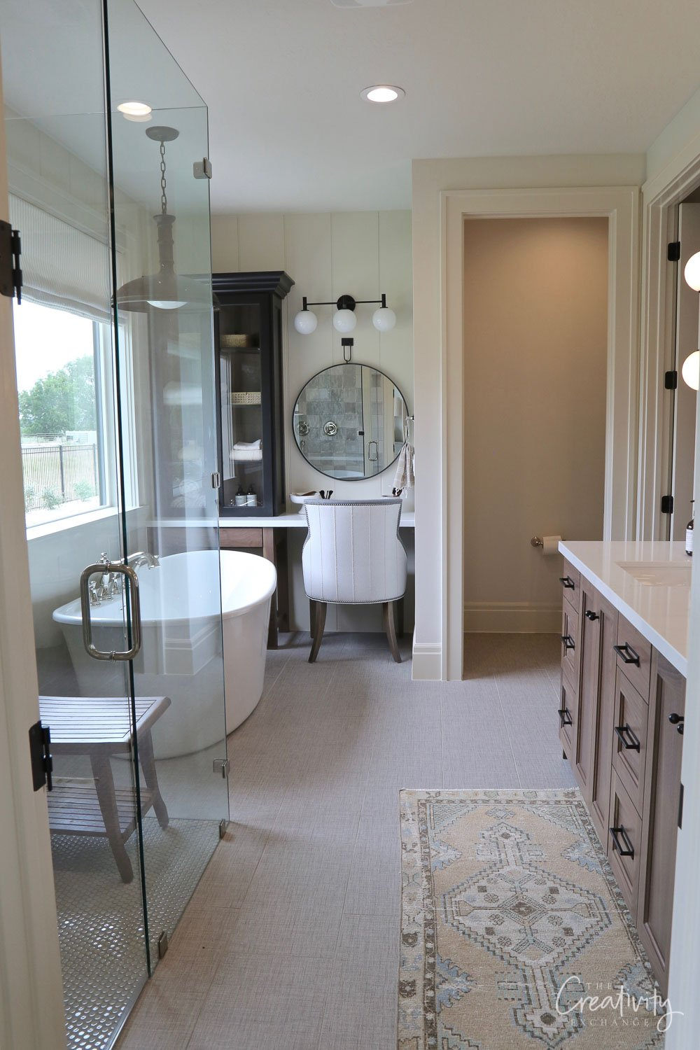Primary bathroom with custom cabinetry