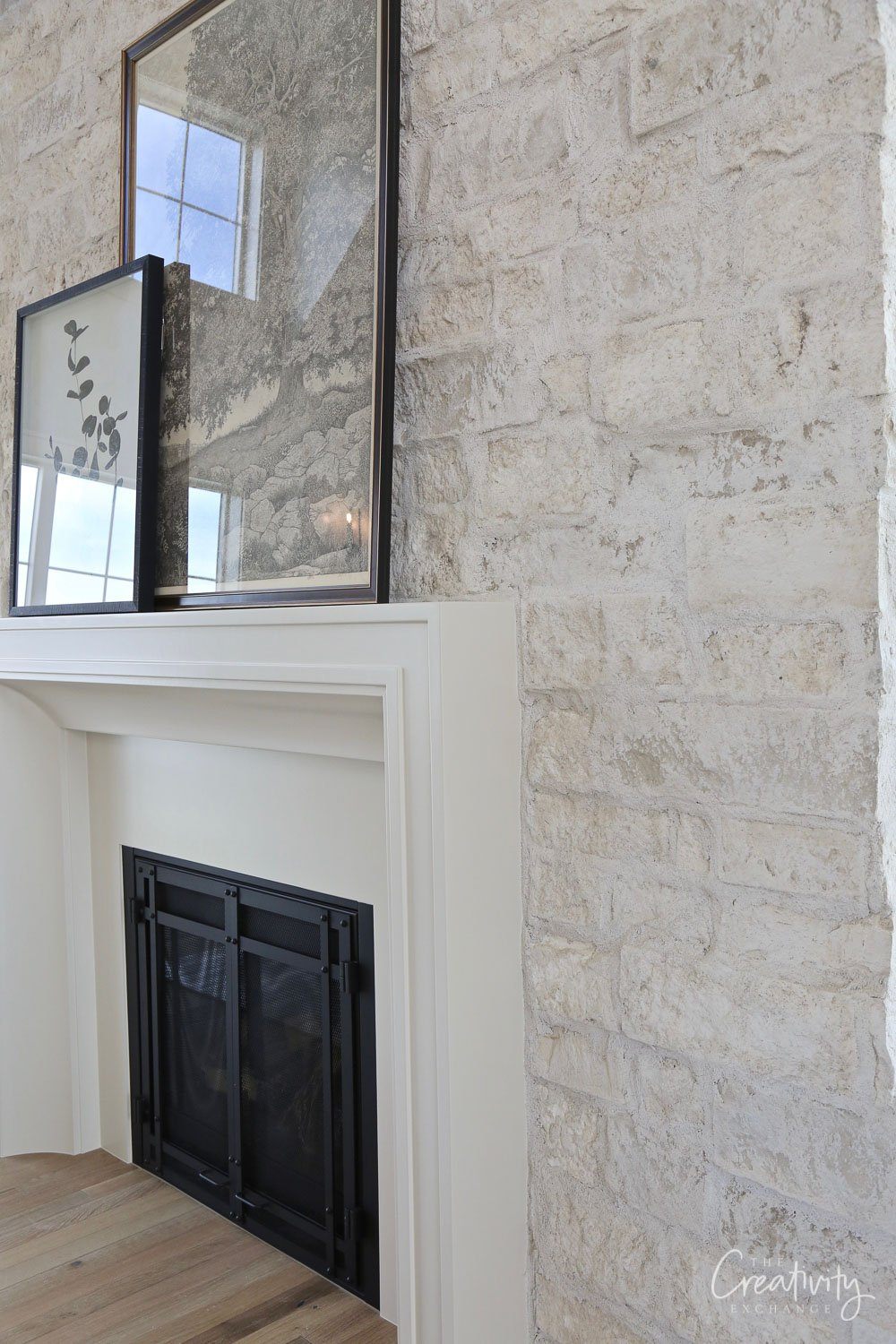 Thin stone veneer wall with a tick mortar wash over the surface