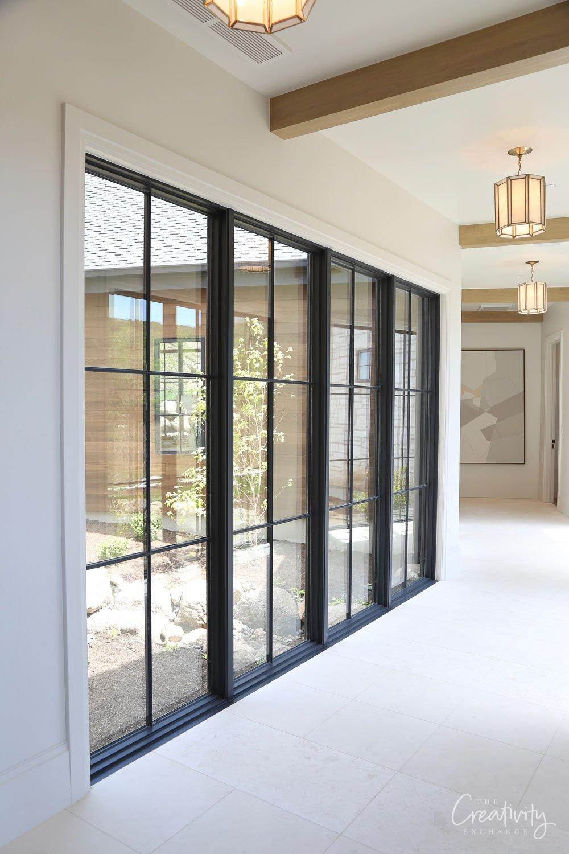 Long hallway with full windows