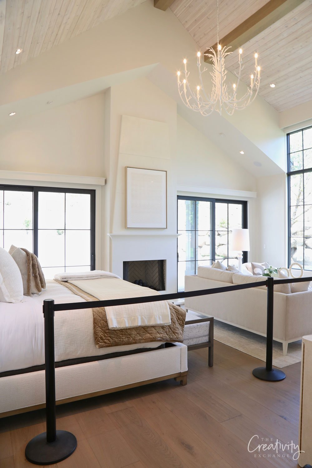 Primary bedroom with vaulted ceilings