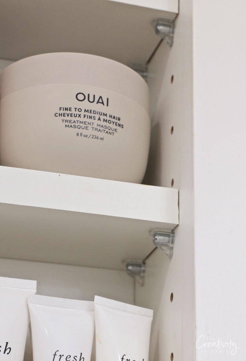 Between the stud adjustable bathroom storage